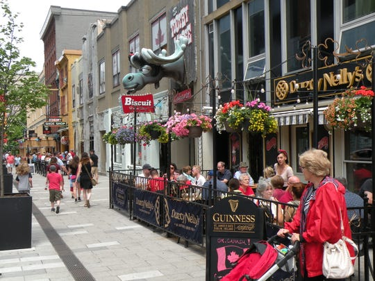 Patrons in Halifax's restaurant district take advantage of pleasant temperatures and request outdoor seating. Halifax is the capital city of Nova Scotia.
