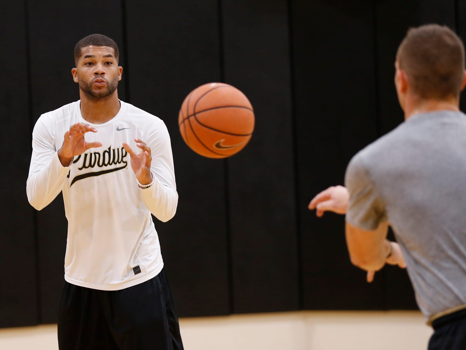 Graduate student manager Joey Brooks catches a pass from fellow graduate student manager D. J. Byrd during the first official practice of the season for Purdue men's basketball Tuesday, September 25, 2018, at Cardinal Court in Mackey Arena.