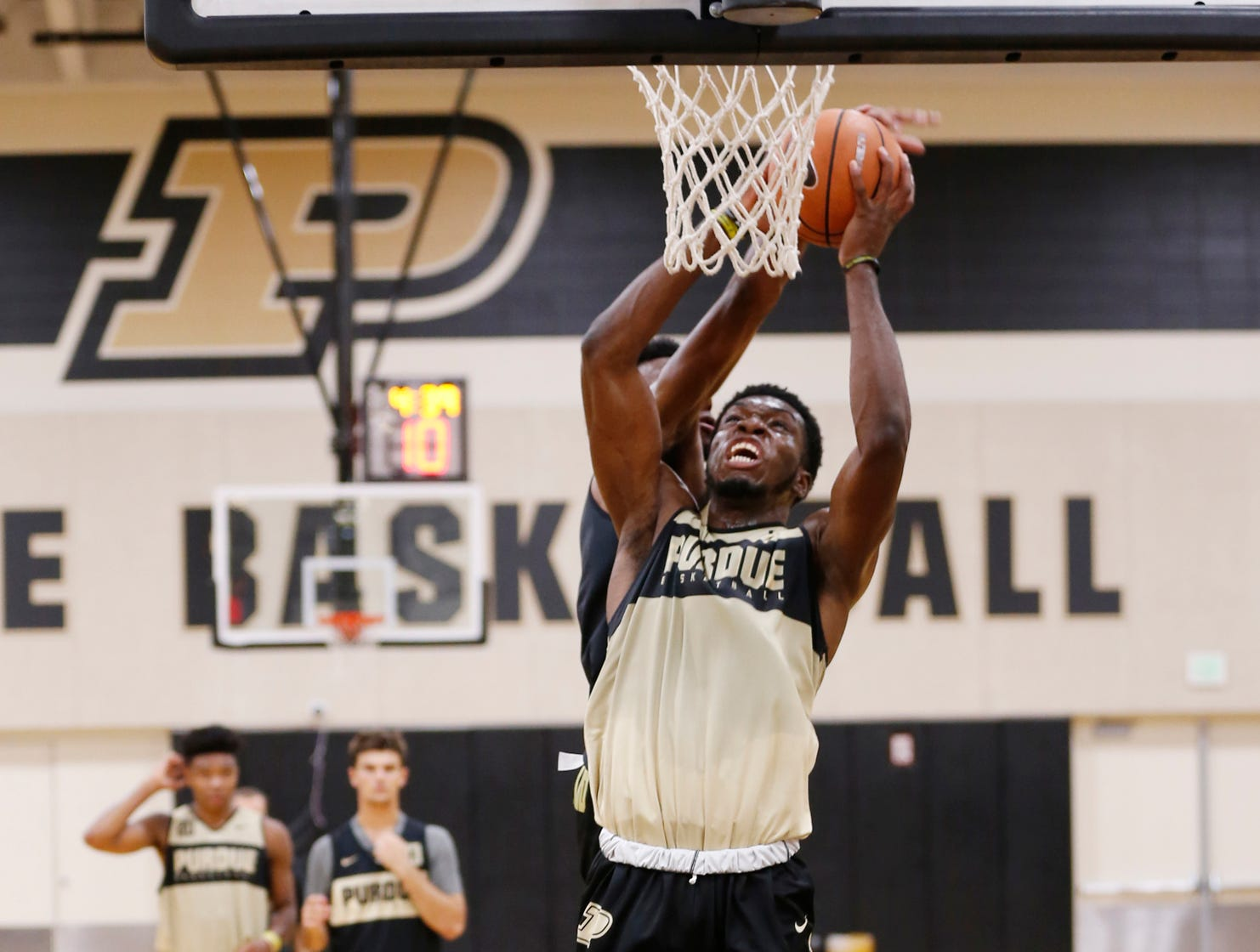 Emmanuel Dowuona with a drive to the basket during the first official practice of the season for Purdue men's basketball Tuesday, September 25, 2018, at Cardinal Court in Mackey Arena.