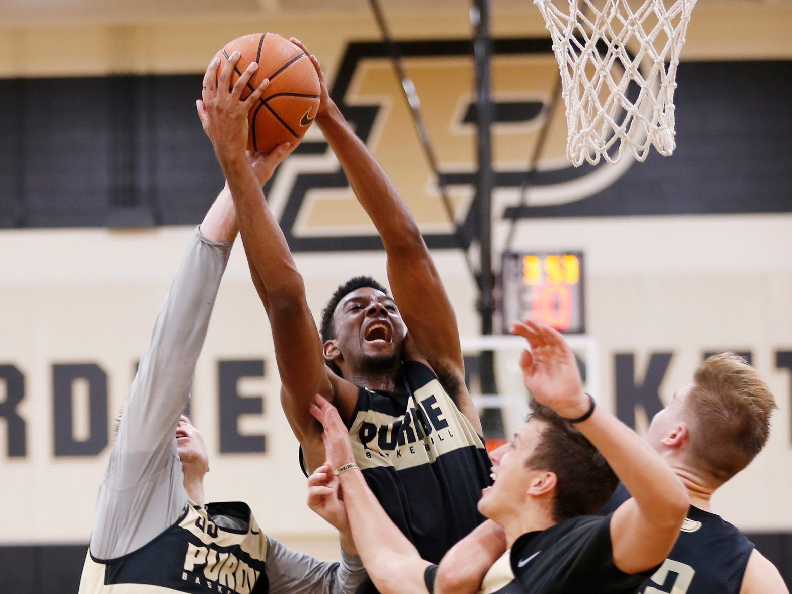 Aaron Wheeler pulls down a rebound during the first official practice of the season for Purdue men's basketball Tuesday, September 25, 2018, at Cardinal Court in Mackey Arena.