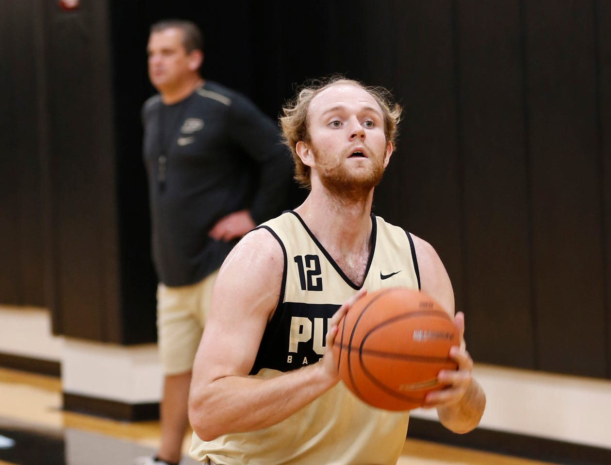 Evan Boudreaux runs a shot fake drill during the first official practice of the season for Purdue men's basketball Tuesday, September 25, 2018, at Cardinal Court in Mackey Arena.