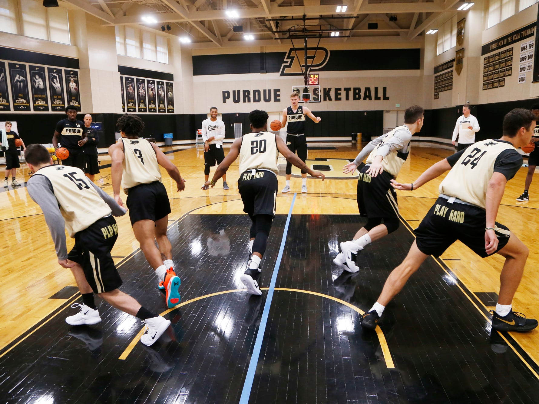 Players begin a drill during the first official practice of the season for Purdue men's basketball Tuesday, September 25, 2018, at Cardinal Court in Mackey Arena.