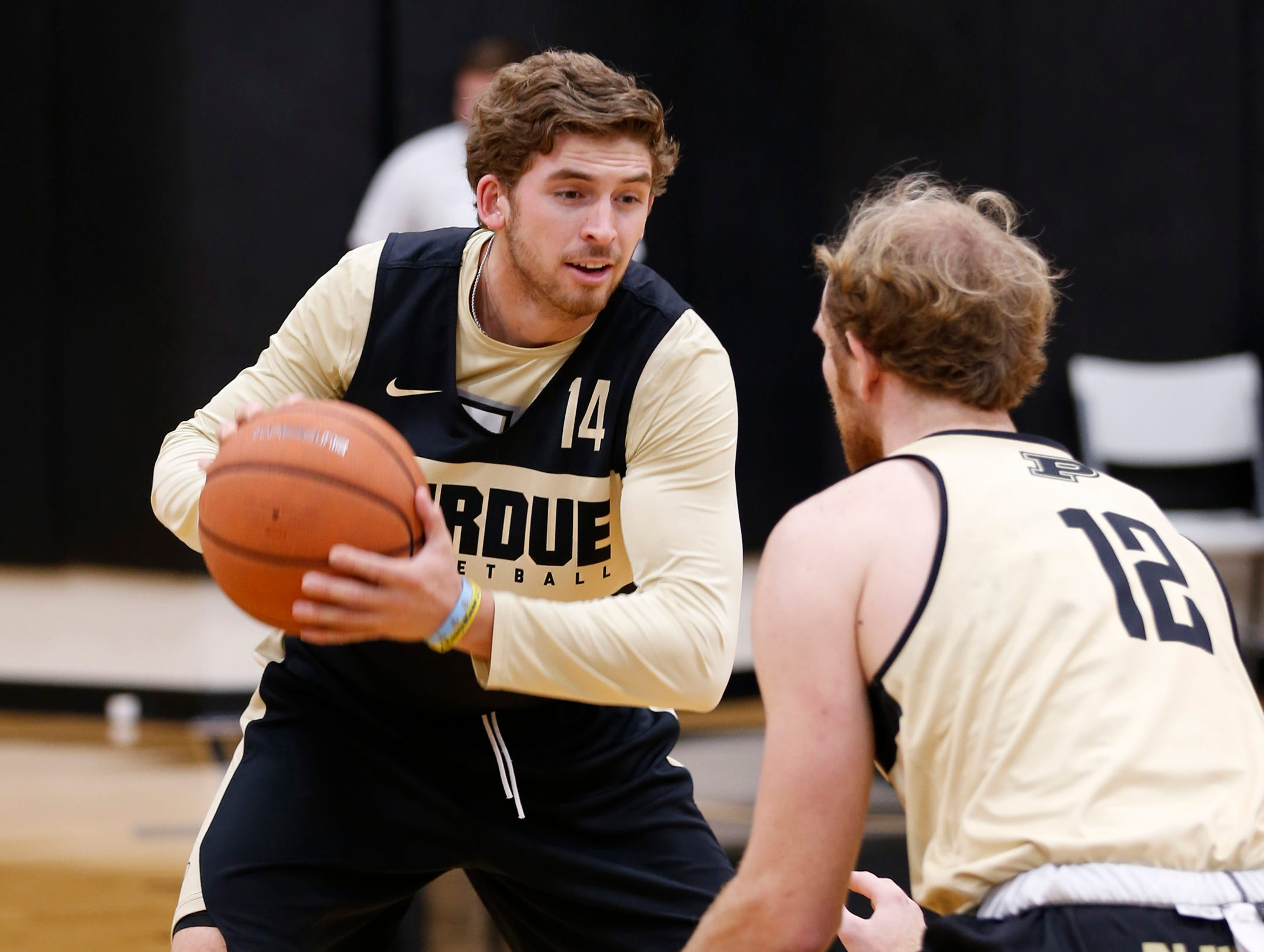 Ryan Cline is marked by Evan Boudreaux during the first official practice of the season for Purdue men's basketball Tuesday, September 25, 2018, at Cardinal Court in Mackey Arena.