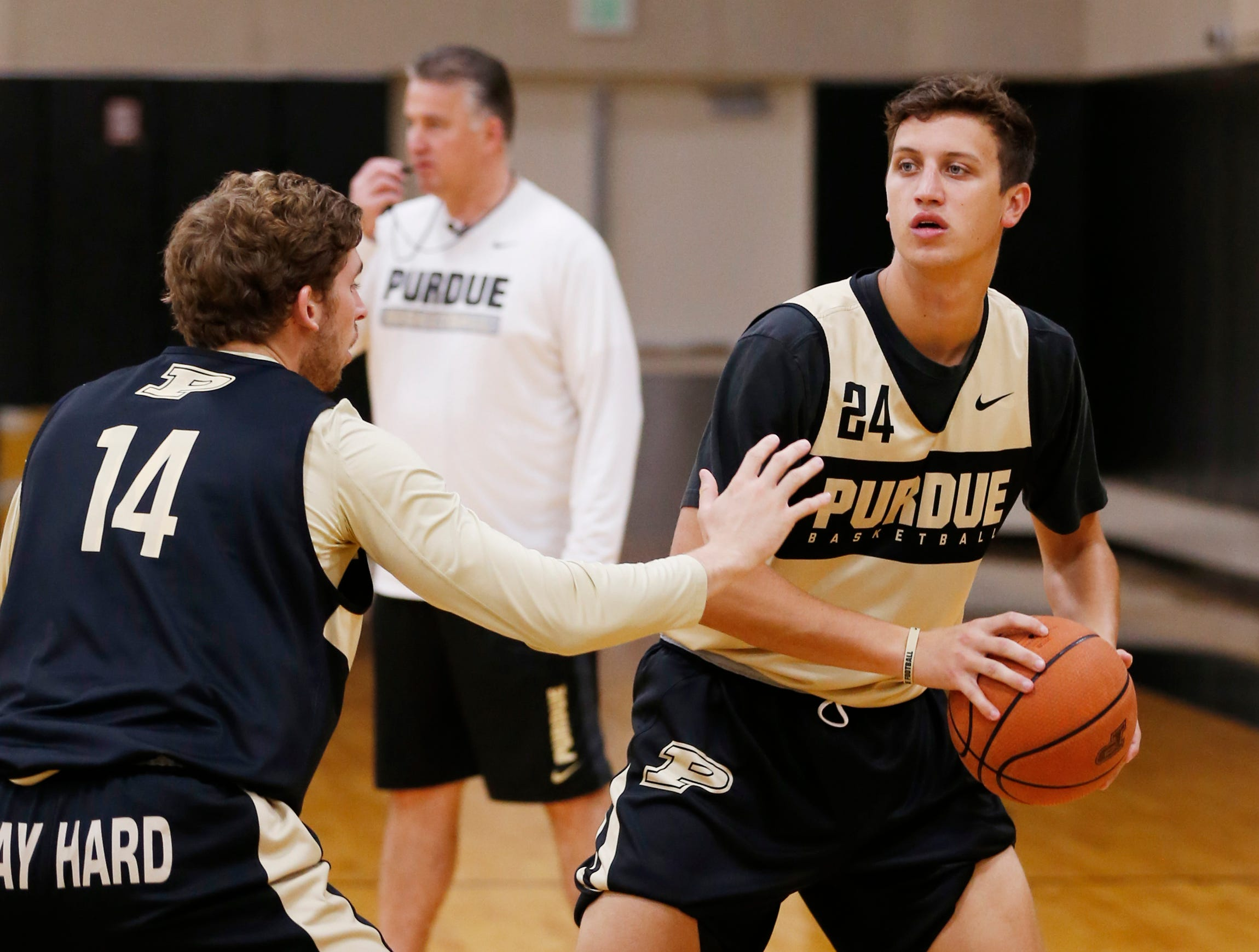 Grady Eifert looks to pass while defended by Ryan Cline during the first official practice of the season for Purdue men's basketball Tuesday, September 25, 2018, at Cardinal Court in Mackey Arena.