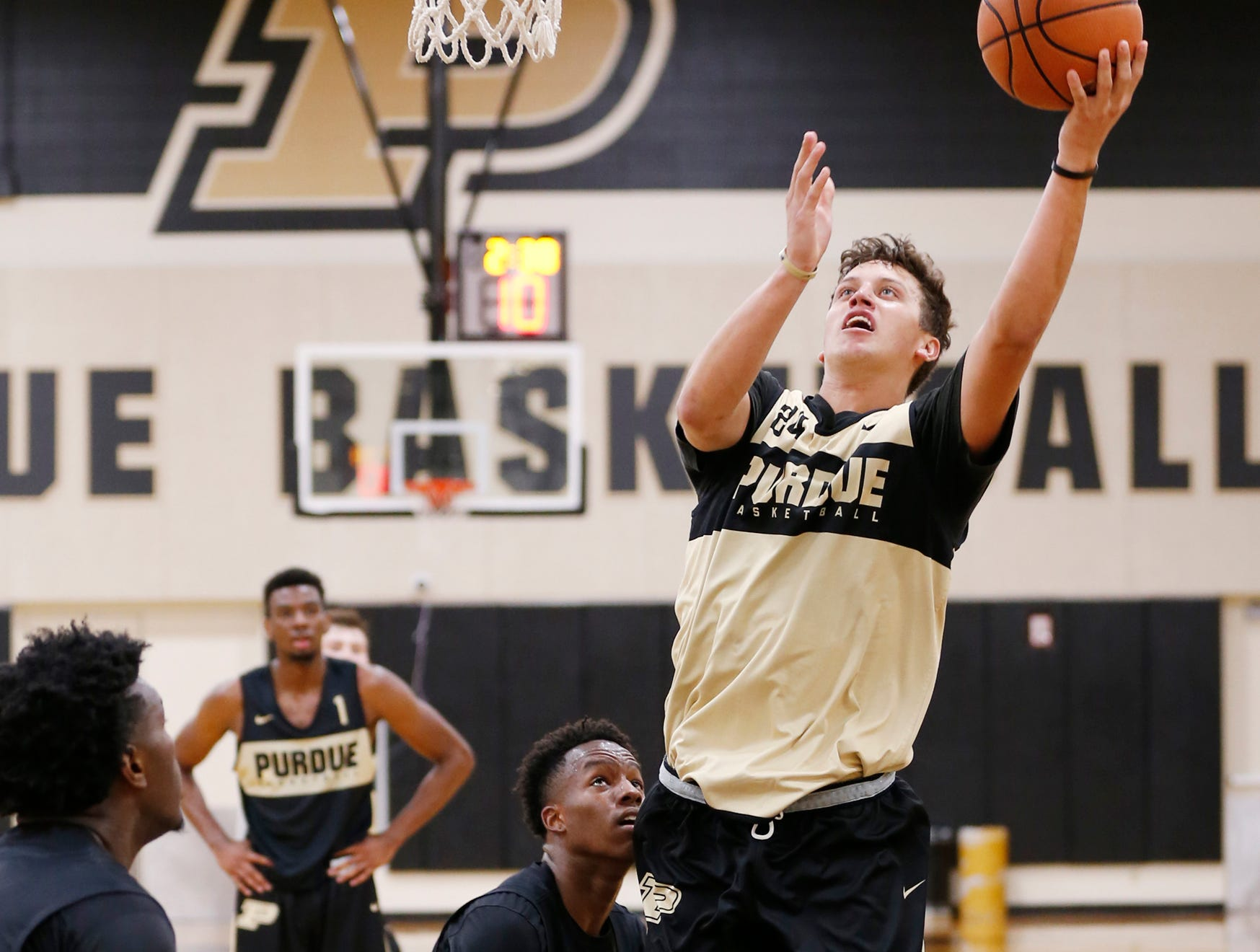 Grady Eifert drives to the basket for a shot during the first official practice of the season for Purdue men's basketball Tuesday, September 25, 2018, at Cardinal Court in Mackey Arena.