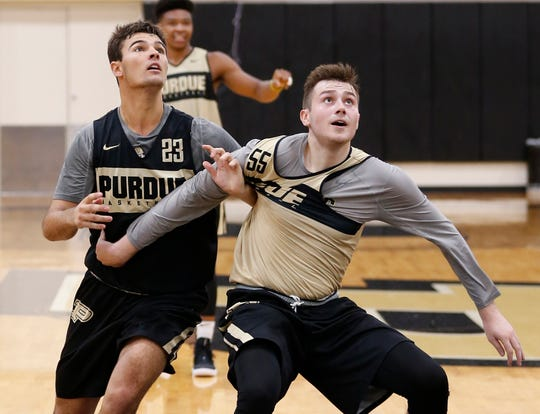 Kyle King and Sasha Stefanovic battle for position during the first official practice of the season for Purdue men's basketball Tuesday, September 25, 2018, at Cardinal Court in Mackey Arena.