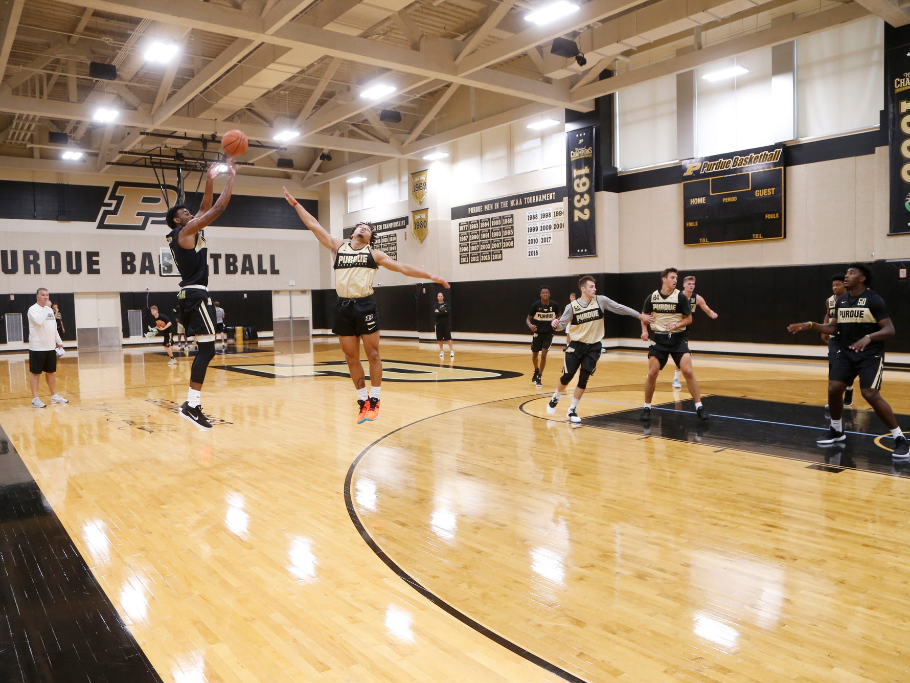 Aaron Wheeler with a shot over Carsen Edwards from beyond the three point line during the first official practice of the season for Purdue men's basketball Tuesday, September 25, 2018, at Cardinal Court in Mackey Arena.