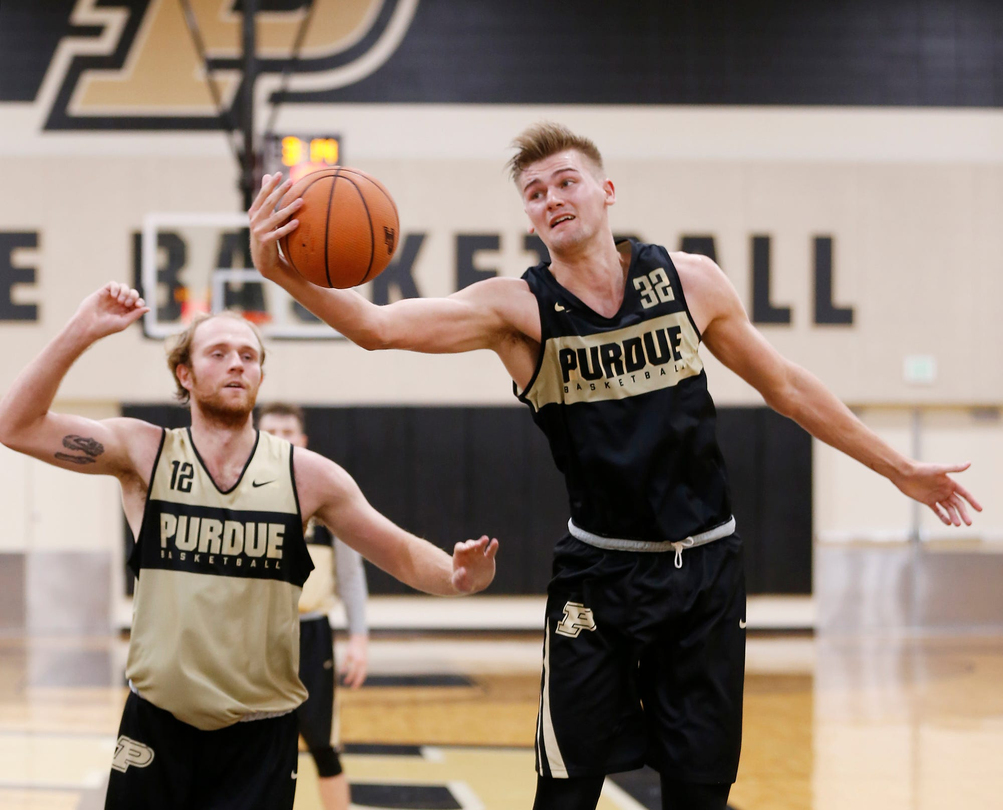 Matt Haarms pulls down a rebound during the first official practice of the season for Purdue men's basketball Tuesday, September 25, 2018, at Cardinal Court in Mackey Arena.