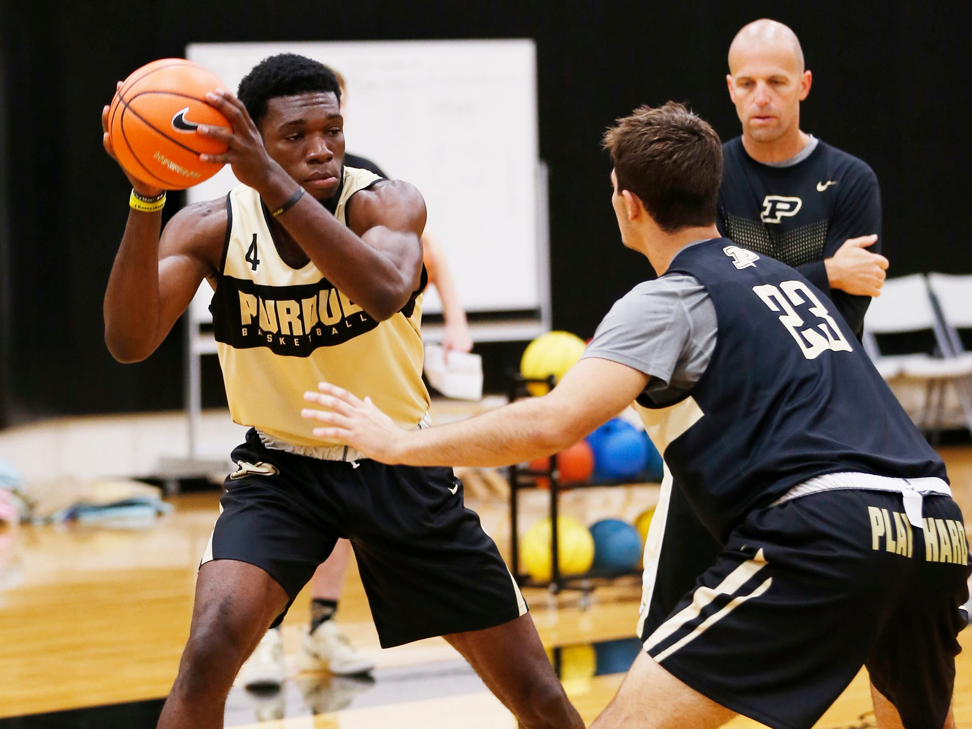 Emmanuel Dowuona looks to pass while guarded by Kyle King during the first official practice of the season for Purdue men's basketball Tuesday, September 25, 2018, at Cardinal Court in Mackey Arena.
