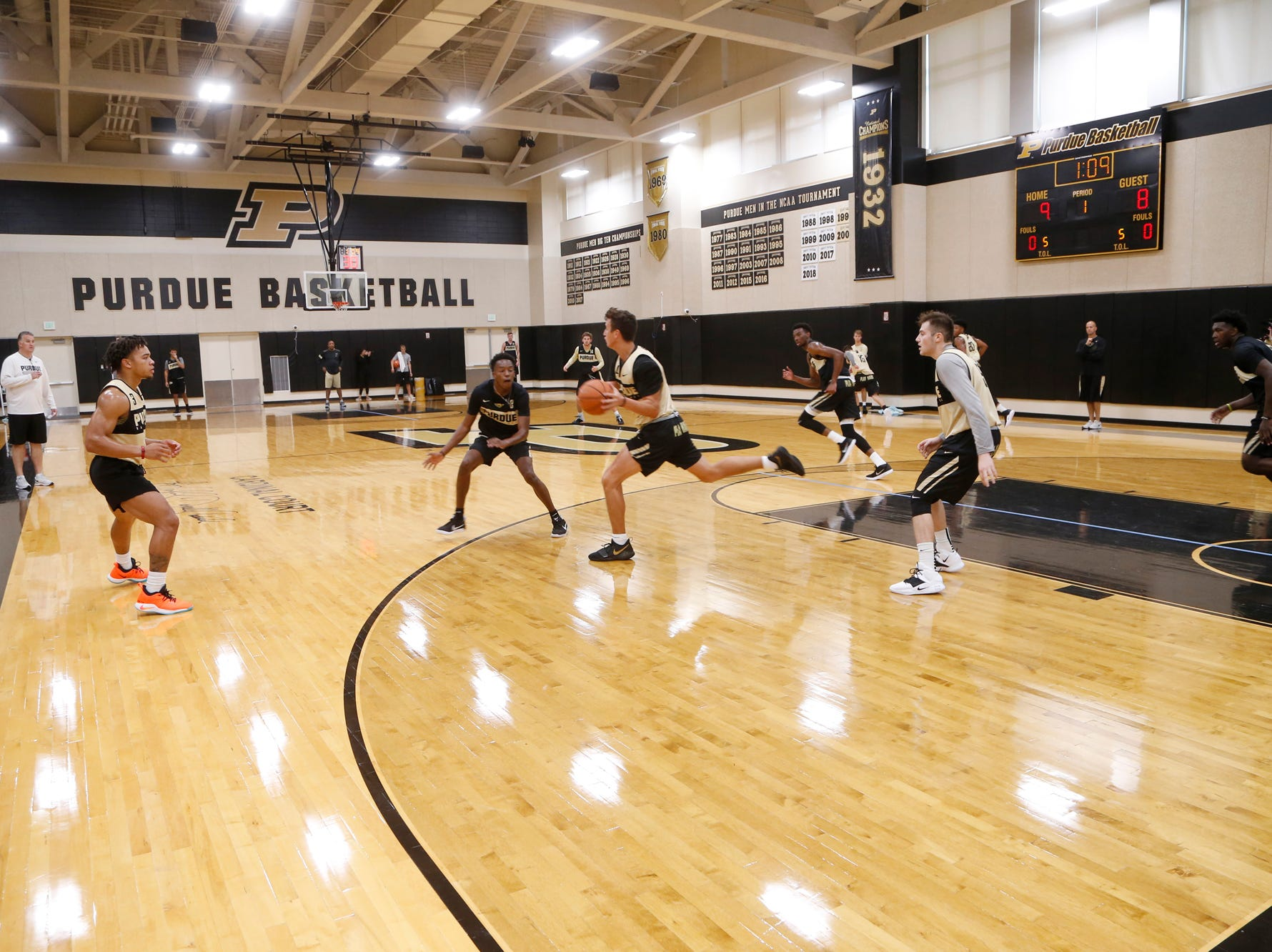 Players work for a shot during the first official practice of the season for Purdue men's basketball Tuesday, September 25, 2018, at Cardinal Court in Mackey Arena.