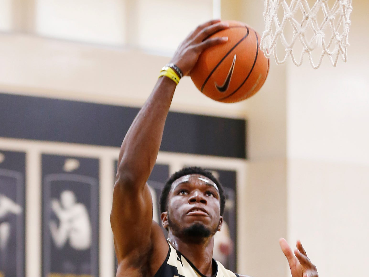 Emmanuel Dowuona with a layup during the first official practice of the season for Purdue men's basketball Tuesday, September 25, 2018, at Cardinal Court in Mackey Arena.