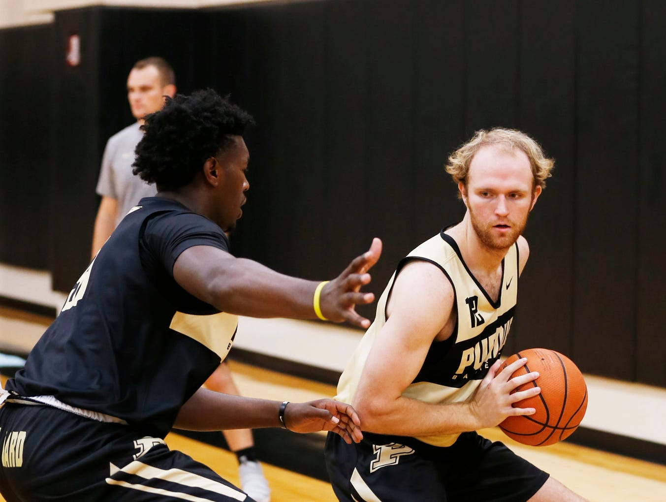 Evan Boudreaux looks to pass while defended by Trevion Williams during the first official practice of the season for Purdue men's basketball Tuesday, September 25, 2018, at Cardinal Court in Mackey Arena.