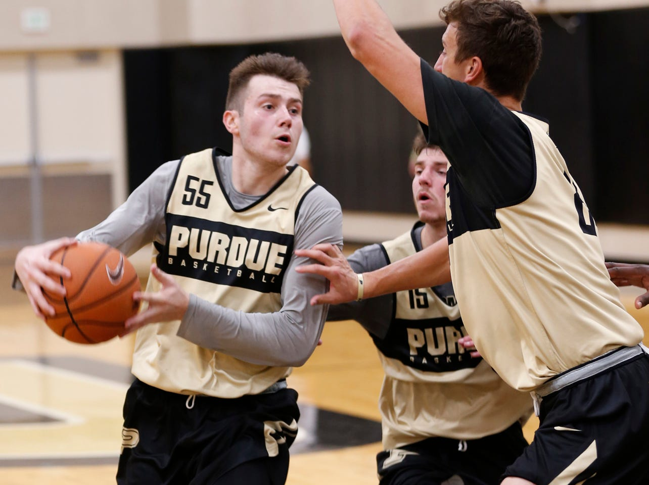 Sasha Stefanovic drives to the basket against Grady Eifert during the first official practice of the season for Purdue men's basketball Tuesday, September 25, 2018, at Cardinal Court in Mackey Arena.