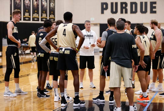 Head coach Matt Painter talks with his players during the first official practice of the season for Purdue men's basketball Tuesday, September 25, 2018, at Cardinal Court in Mackey Arena.