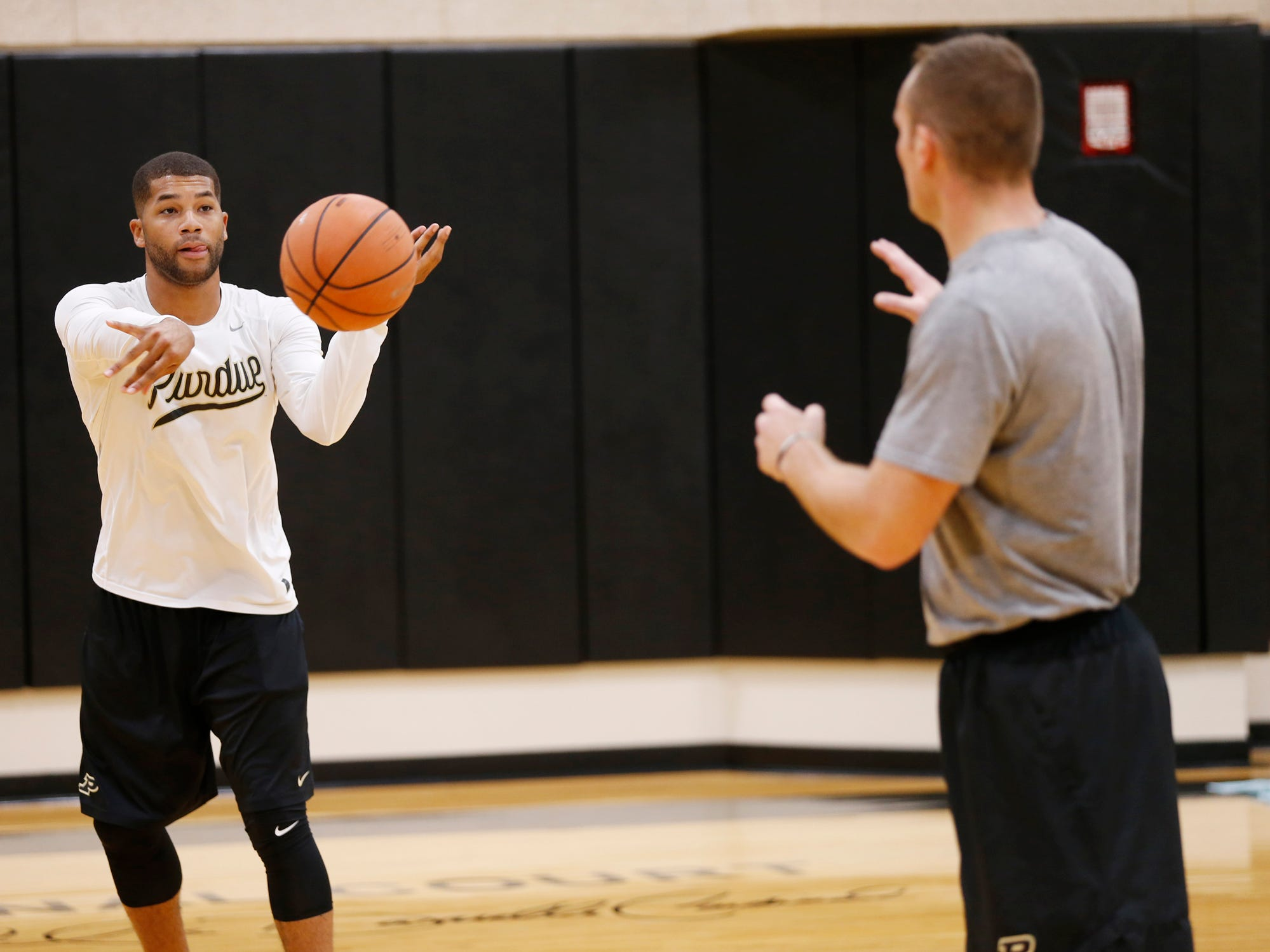 Graduate student manager Joey Brooks passes the ball to fellow graduate student manager D. J. Byrd during the first official practice of the season for Purdue men's basketball Tuesday, September 25, 2018, at Cardinal Court in Mackey Arena.