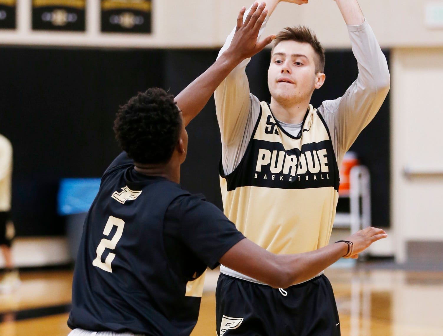 Sasha Stefanovic looks to pass while guarded by Eric Hunter Jr. during the first official practice of the season for Purdue men's basketball Tuesday, September 25, 2018, at Cardinal Court in Mackey Arena.