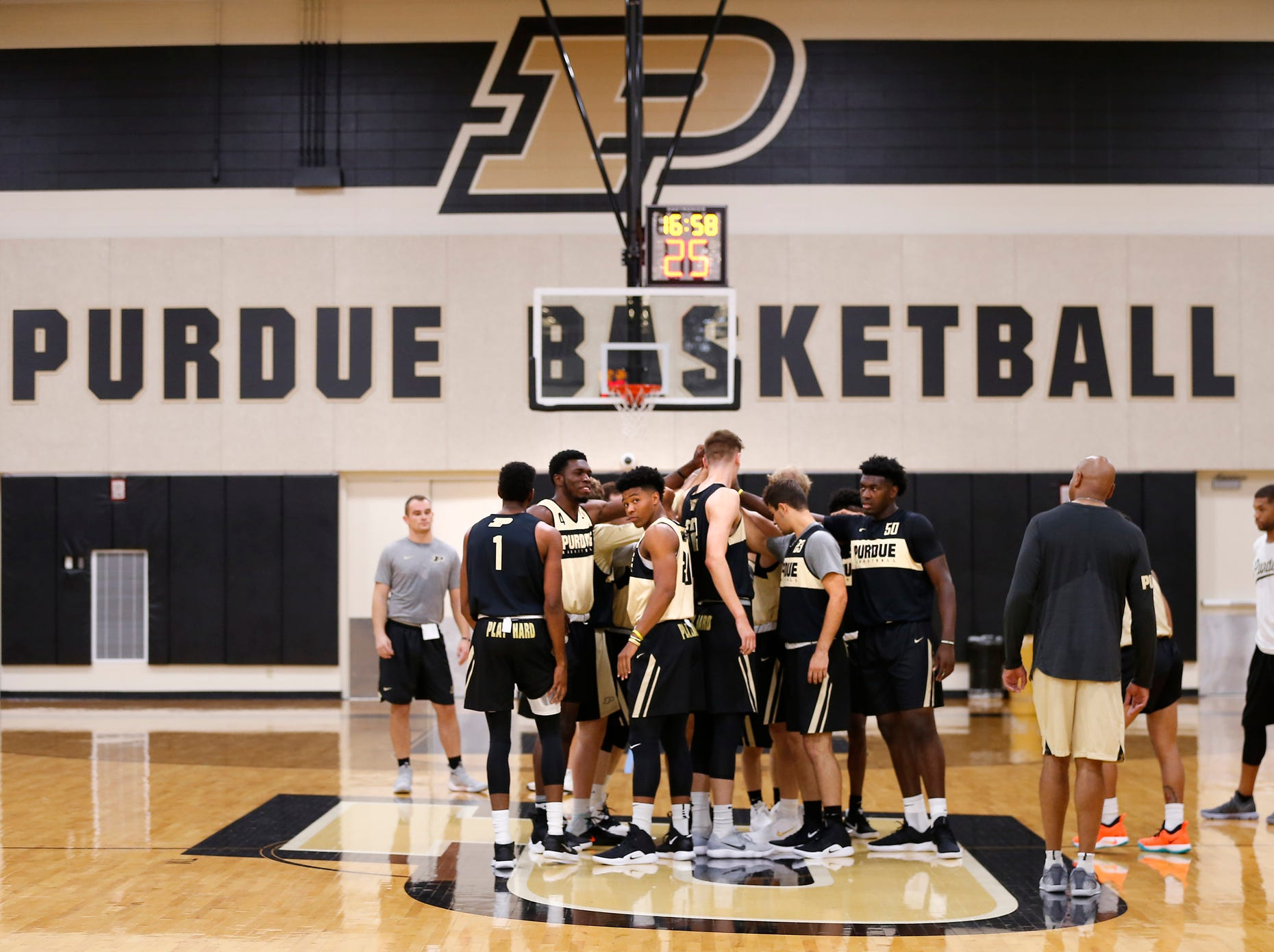 Purdue players join hands at the start of the first official practice of the season Tuesday, September 25, 2018, at Cardinal Court in Mackey Arena.