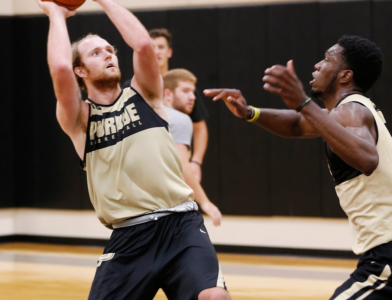 Evan Boudreaux puts up a shot over Emmanuel Dowuona during the first official practice of the season for Purdue men's basketball Tuesday, September 25, 2018, at Cardinal Court in Mackey Arena.