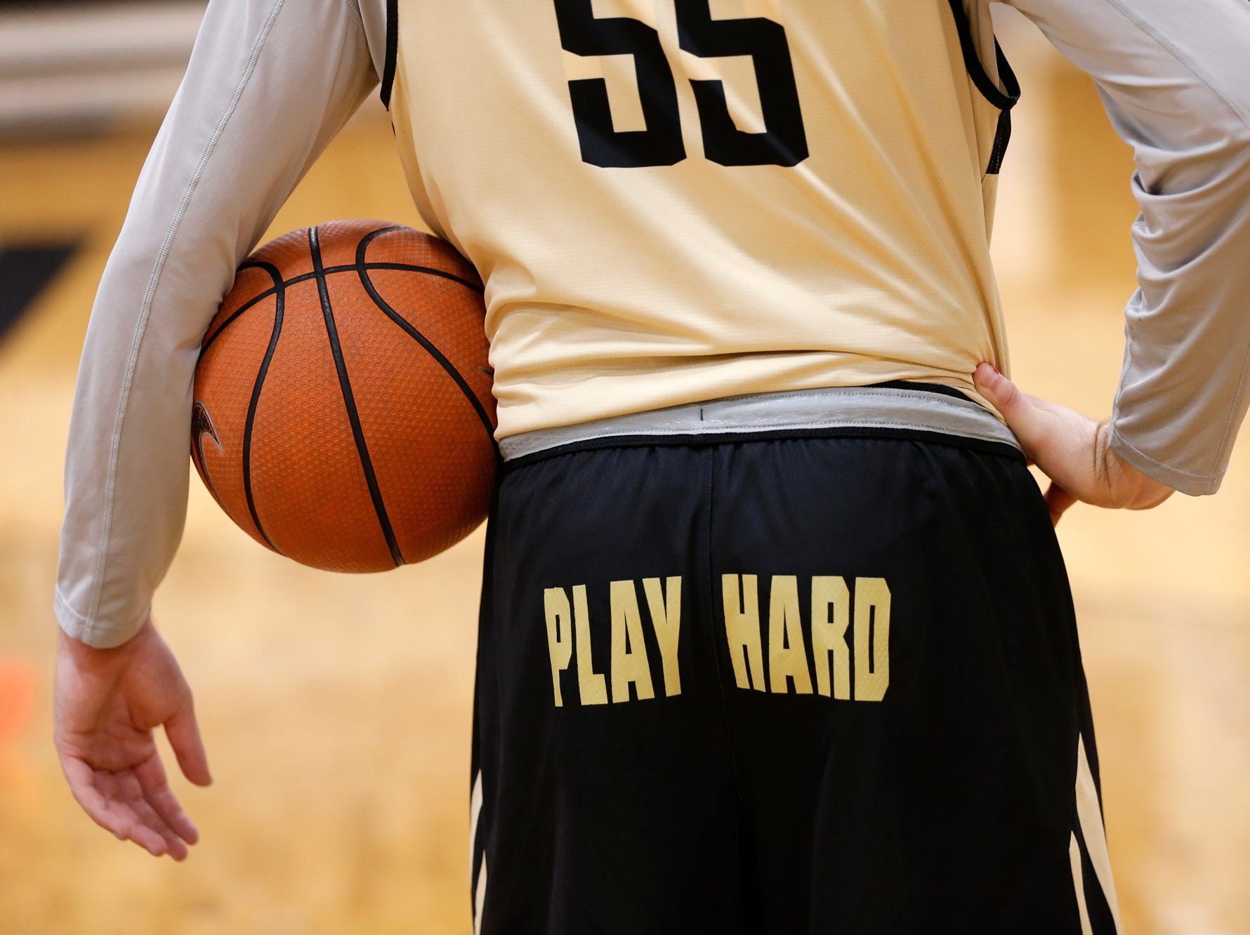 Sasha Stefaonvic holds the ball as head coach Matt Painter gives instructions during the first official practice of the season for Purdue men's basketball Tuesday, September 25, 2018, at Cardinal Court in Mackey Arena.