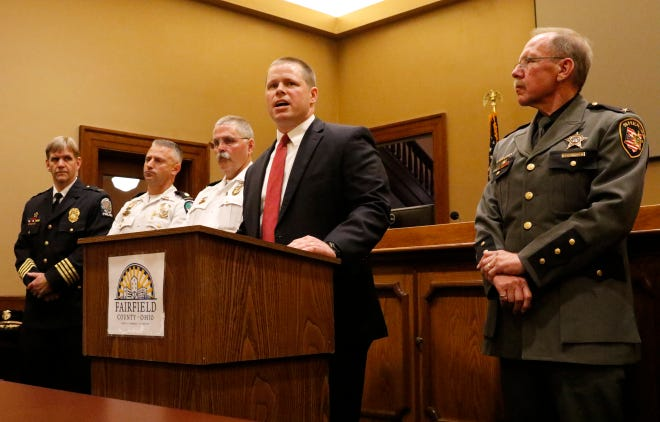 Fairfield County Prosecutor Kyle Witt speaks at press conference opposing Ohio Issue 1 Tuesday, Sept. 25, 2018, in Lancaster. Witt, other law enforcement officials, judges and other elected and appointed officials voiced their opposition to the proposed constitutional amendment. Issue 1 would amend the Ohio constitution, would turn certain drug crimes into misdemeanors thus lessoning the penalties among other changes to the criminal justice