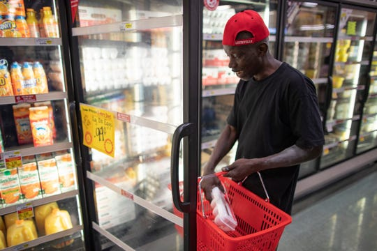 "Robert Maddox picks up eggs in the Cash Saver grocery store on Wilson Avenue. ""I used to live in the west end so I still come to shop at this store just to give back to the community,"" Maddox said. ""Here you might get eggs for 99 cents, but they're 79 cents at Kroger."" Sept. 25, 2018"