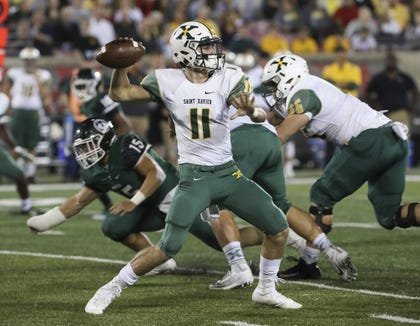 St. Xâ's QB Jack Albers (11) passed against Trinity during their game at Papa John's Cardinal Stadium.Sep. 29, 2017