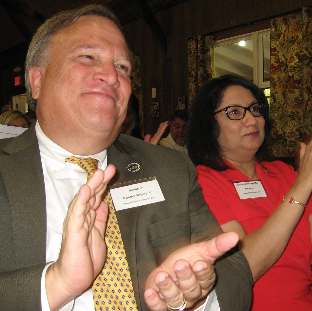 Kentucky Senate President Robert Stivers, left, and U of L President Neeli Bendapudi, applauded after a performance by the Red Bird Mission school choir at a Sept. 20 open house.