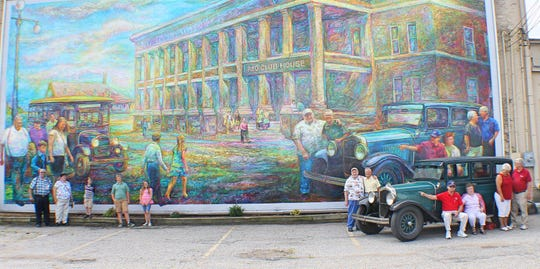 "The ""Community Heart of REO"" mural features the REO Motors and Diamond Reo facilities, the REO Clubhouse and a 1927 REO."