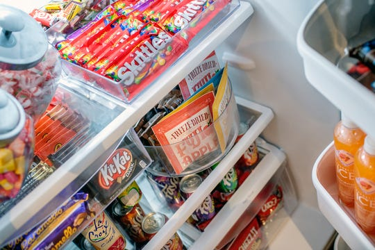 The refrigerator in a sample apartment is filled with treats for potential renters during an open house at the Hub leasing office on Wednesday, Sept. 19, 2018, in East Lansing.