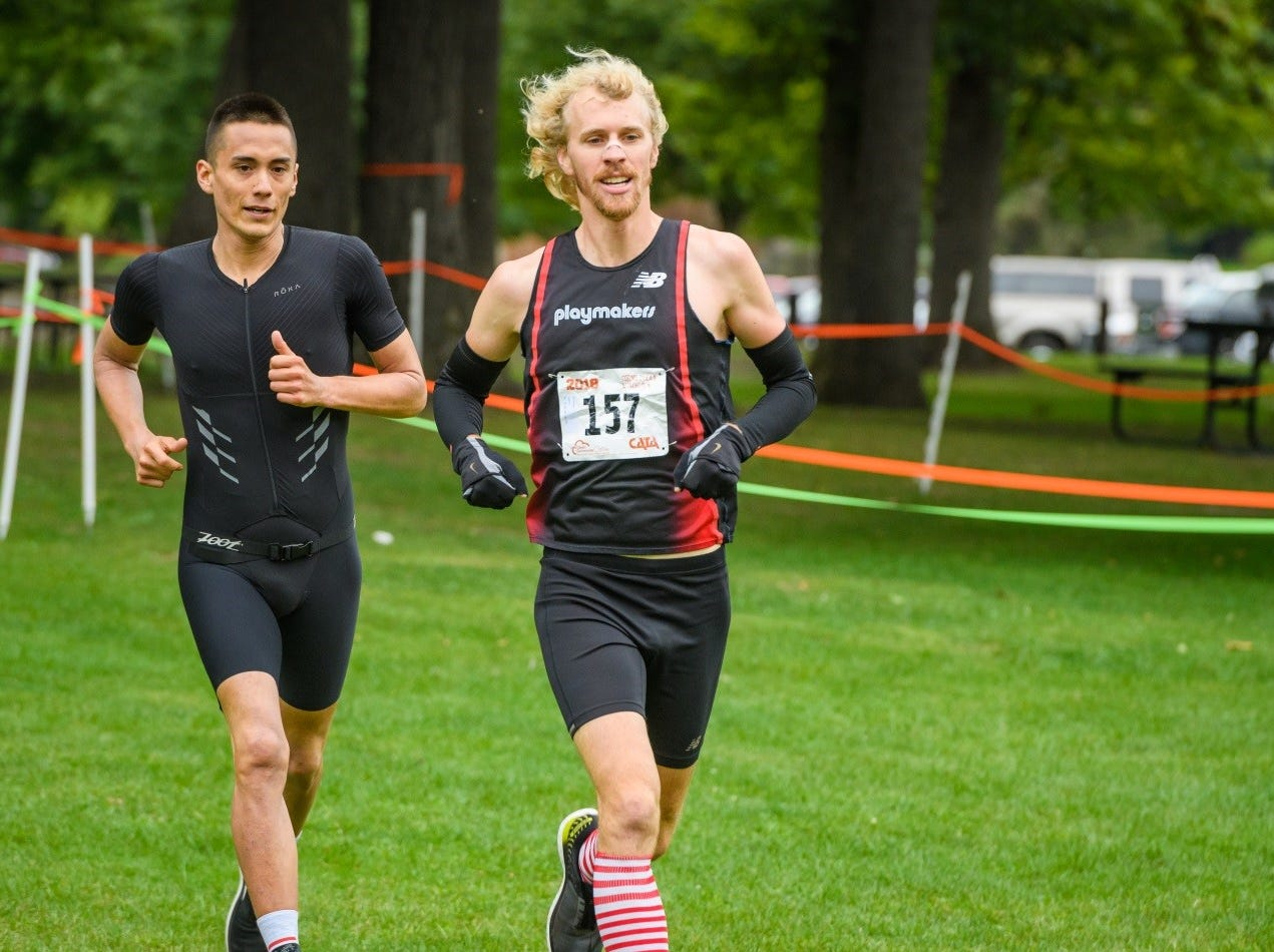 Louie Cayedito (left) and Alex Russeau (right), our first and third place overall finishers rounding out the first run portion of the duathlon.
