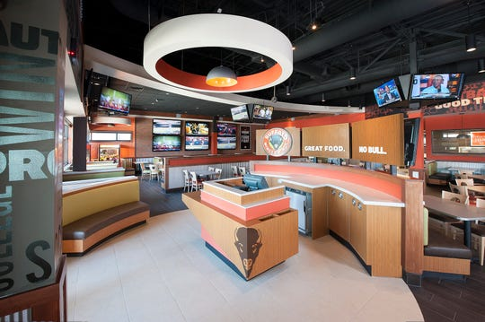A photo of the interior of Buffalo Wings & Rings, a Cincinnati-based sports restaurant. A company official said the chain is looking at the Lansing area for its first Michigan location.