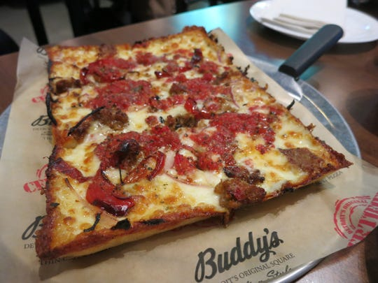 The Ultimate Italian thin-crust pizza at the Buddy's Pizza in Novi is topped with Italian sausage, roasted red pepper and red onion.  The company is interested in the Lansing market, a company official said.