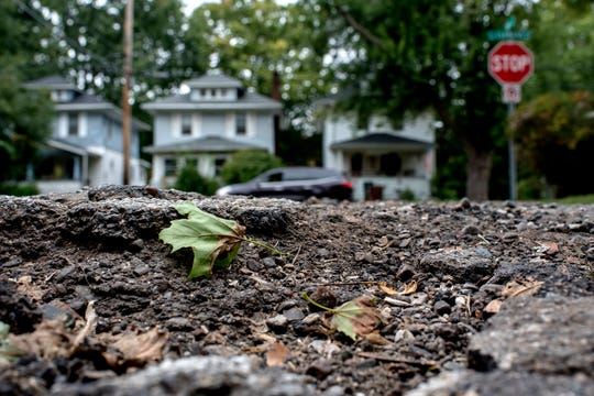 The view from inside a pothole on Vine Street near Clemens Avenue intersection on Monday, Sept. 24, 2018, in Lansing.