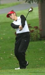 Shelby's Amanda Ruminski chips the ball during the girls sectional golf tournament at Valley View Golf course in Crestline.