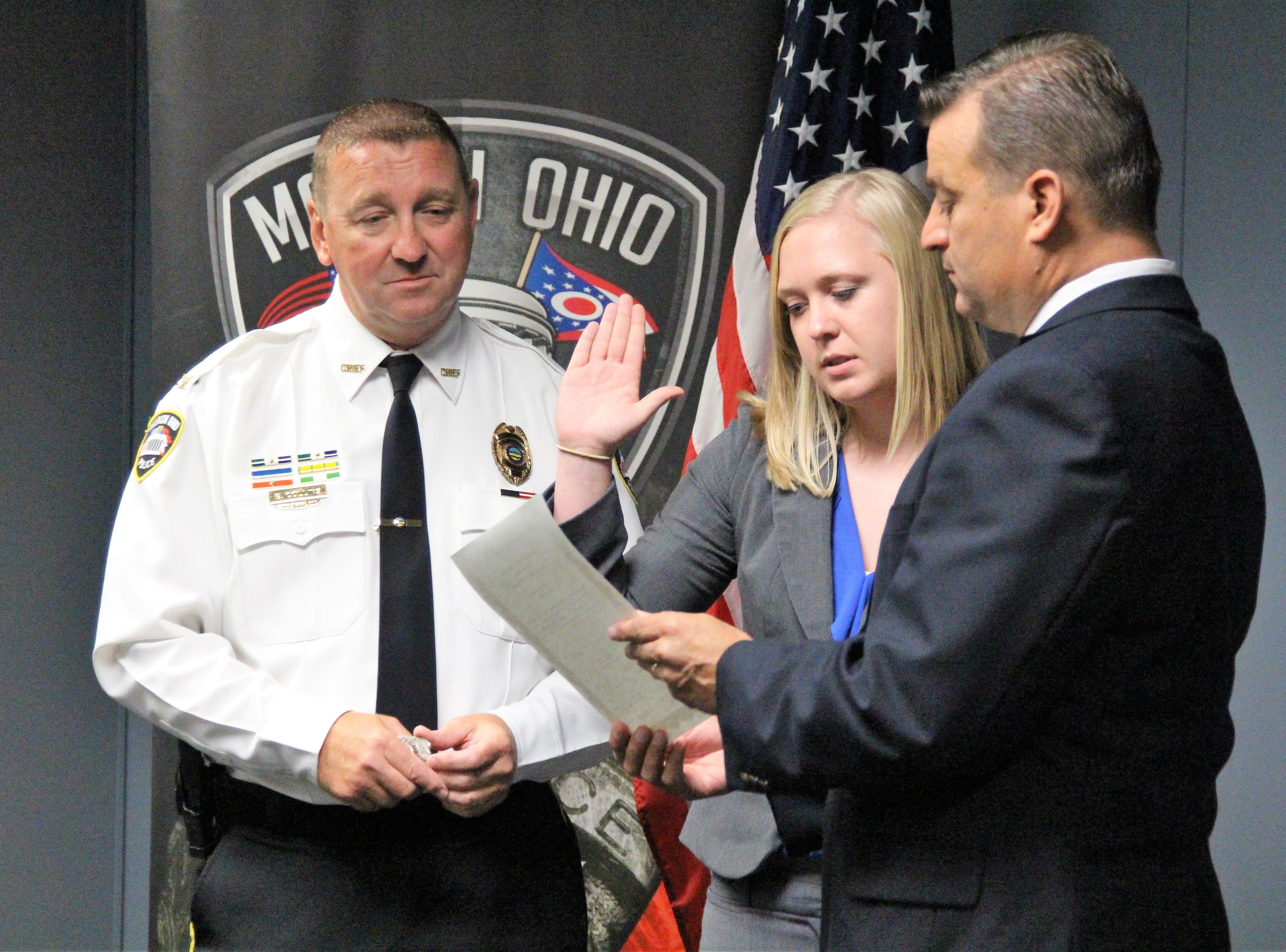 Marion Police Chief Bill Collins watches as new hire Kaitlyn Meadows is issued the oath of office by Mayor Scott Schertzer on Monday. The Marion Police Department now has 53 sworn-in officers. However Collins said that is down from the departments ideal 65-member roster.