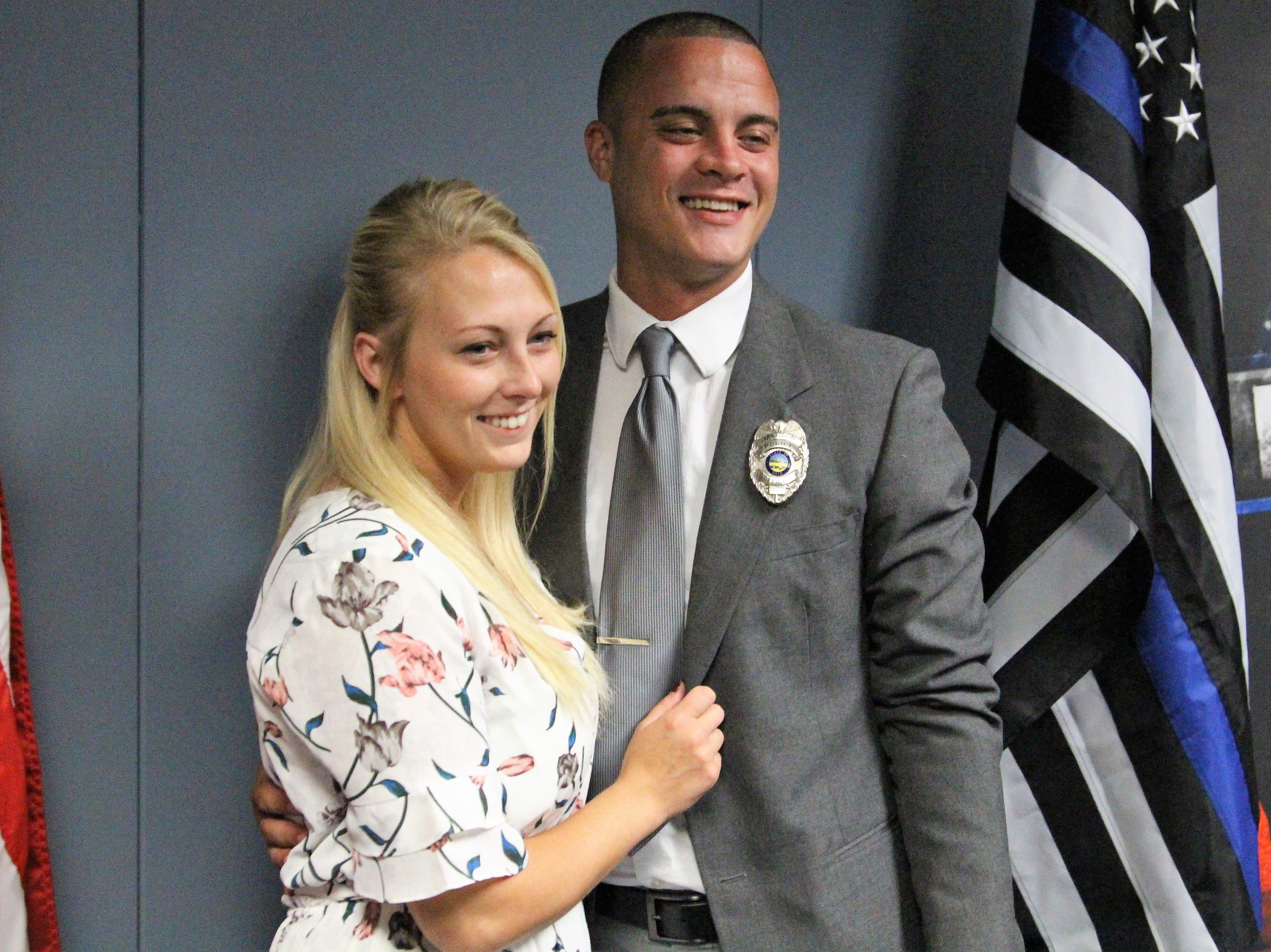 New Marion patrol officer Sebastian Walker poses with his wife Courtney after being issued the oath of office on Monday.