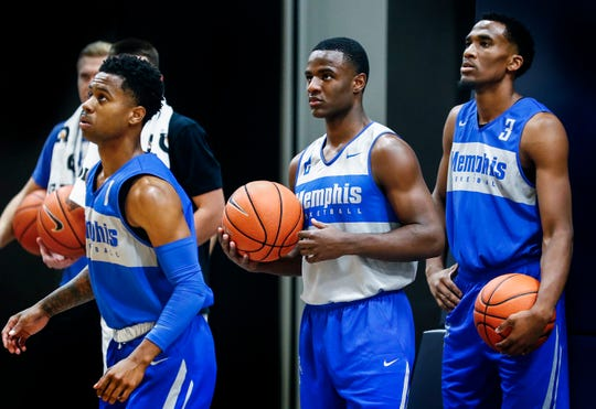 Memphis Tigers teammates (left to right) Tyler Harris, Alex Lomax, and Jeremiah Martin during an open practice Tuesday afternoon at the Laurie-Walton Family Basketball Center.