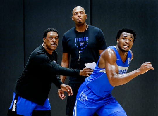 Memphis Tigers new head coach Penny Hardaway drills his team with assistant coach Tony Madlock (left) and forward Victor Enoh (right) during an open practice Tuesday afternoon at the Laurie-Walton Family Basketball Center.
