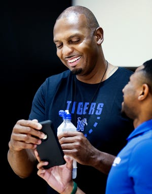Memphis head coach Penny Hardaway (left) jokes with former Tiger Trey Draper during an open practice Tuesday afternoon at the Laurie-Walton Family Basketball Center.