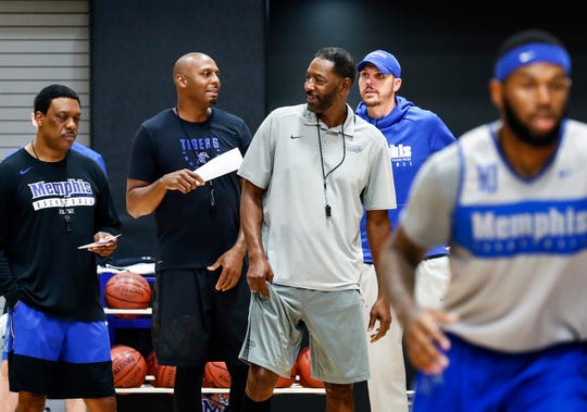Memphis coaches (left to right) Tony Madlock, head coach Penny Hardaway, Sam Mitchell, Mike Miller during an open practice Tuesday afternoon at the Laurie-Walton Family Basketball Center.
