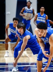 Memphis freshman David Wingett (middle) runs through warmups during an open practice Tuesday afternoon at the Laurie-Walton Family Basketball Center.