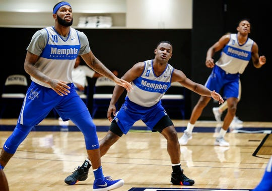 Memphis teammates (left0 to right) Mike Parks Jr., Alex Lomax, and Kyvon Davenport during an open practice Tuesday afternoon at the Laurie-Walton Family Basketball Center.