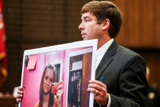 Deputy Prosecutor Jay Hale holds up a picture of Jessica Chambers on the first day of the retrial of Quinton Tellis in Batesville, Mississippi on Tuesday.
