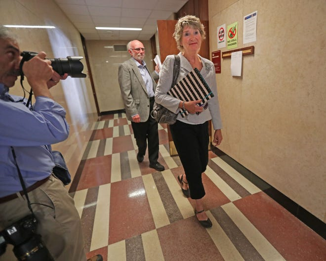 Racine Common Council member Sandra Weidner leaves the courtroom followed by Ken Yorgan, an open records advocate and candidate running for the congressional seat of outgoing House Speaker Paul Ryan. Weidner appeared in a Racine County court in Racine to face the city attorney's request that she be sanctioned for discussing her own open records lawsuit that a judge ordered completely sealed from the public.