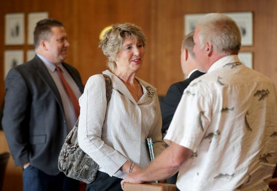 Racine Common Council member Sandra Weidner talks to open records advocate Harry Wait as she appeared in a Racine County court to face the city attorney's request that she be sanctioned for discussing her own open records lawsuit that a judge ordered completely sealed from the public.