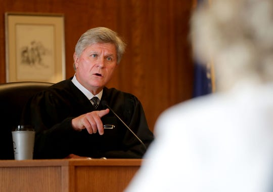 Racine County Circuit Judge Eugene Gasiorkiewicz presides as Racine Common Council member Sandra Weidner appeared in court on Tuesday to face the city attorney's request that she be sanctioned for discussing her own open records lawsuit that a judge ordered completely sealed from the public.