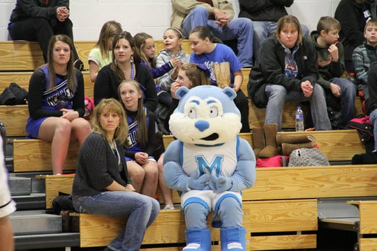 Chipper sits with the cheerleaders in the Mellen High School gym.