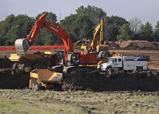Construction and earth-moving equipment work on the Foxconn development area in Mount Pleasant.