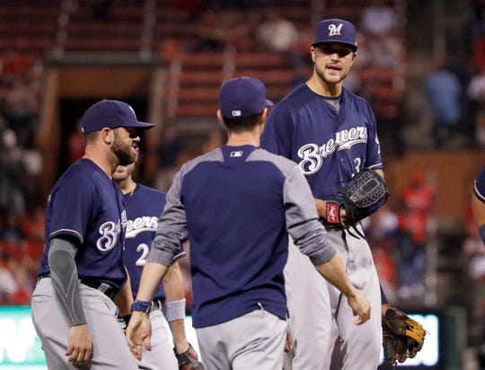 Brewers manager Craig Counsell comes out to the mound to remove Dan Jennings, who started the game but faced just one batter against the Cardinals on Monday night.