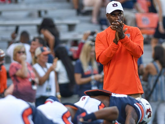 Auburn defensive backs coach Marcus Woodson watches warm ups before the Arkansas game Saturday, Sept. 22, 2018, at Jordan-Hare Stadium in Auburn, Ala.
